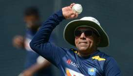 Sri Lankan cricket team head coach Chandika Hathurusingha throws a ball during a practice session at