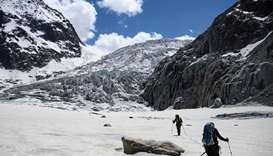 Climbers hike walk on the Mer de Glace glacier in Chamonix