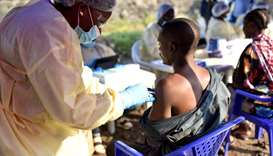 A Congolese health worker administers an Ebola vaccine to a man at the Himbi Health Centre in Goma,