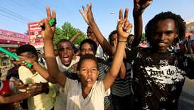 Sudanese people chant slogans as they celebrate, after Sudan's ruling military council and a coaliti
