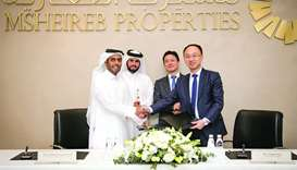 Msheireb Properties and Huawei officials at the cooperation agreement signing ceremony