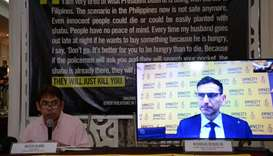 Butch Olano (L), Amnesty International section representative speaks while Nicholas Bequelin (video