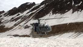 A helicopter being used to retrieve the bodies of mountaineers from Nanda Devi is pictured at base c