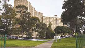 Police tape blocks an entrance at a public housing estate which is undergoing a forced lockdown in M