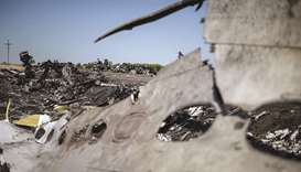 In this file photo, a part of the Malaysia Airlines Flight MH17 at the crash site in the village of