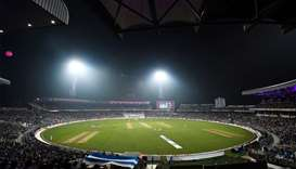 file photo:  Cricketers play under floodlights at the Eden Gardens cricket stadium in Kolkata