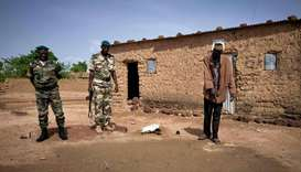 Boubou Sangare (R) shows Malian gendarmerie in Fana on June 30, 2020, the site where his brother's h