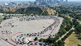 An aerial view of motorists lined up to be tested for COVID-19 in a parking lot at Dodger Stadium am
