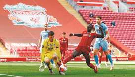 Liverpool's striker Sadio Mane (second) tries to score past Burnley's goalkeeper Nick Pope during th