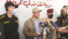 At border, Iraq PM vows to fight customs corruption