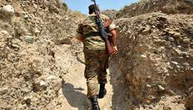 An Armenian soldier of the self-proclaimed republic of Nagorno-Karabagh walks in a trench at the fro