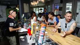 "Bar patrons attend the reopen Florida ""maskless"" rally and dinner held at 33 & Melt restaurant to pr"