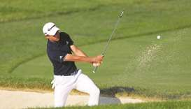 Collin Morikawa of the United States plays a shot from a bunker on the 13th hole during the second r
