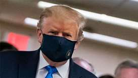 Trump finally dons mask as US sets new virus case record