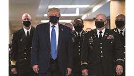 Trump finally dons a face mask