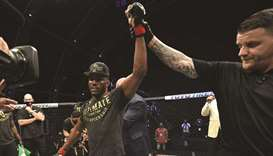 Kamaru Usman of Nigeria celebrates after his victory over Jorge Masvidal in their UFC welterweight c