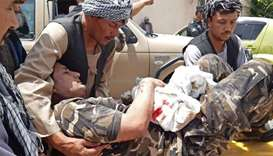 A wounded personnel of National Directorate of Security (NDS) is brought on a stretcher to a hospita