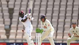 West Indies' Jermaine Blackwood (left) plays a shot as England's Jos Buttler (centre) keeps wicket o