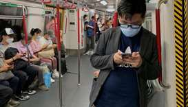Passengers wear surgical masks in an MTR train, following the outbreak of the coronavirus in Hong Ko
