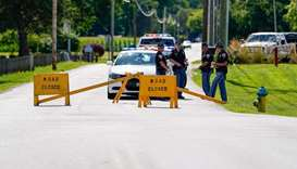 Indiana State Troopers block a road leading to the Federal Correctional Institute, Terre Haute, as o