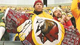 In this file photo taken on December 8, 2019, a Washington Redskins fan unfurls a flag during the ga