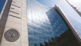 The Securities and Exchange Commission stands in Washington, DC (file). The SEC amended rules last y