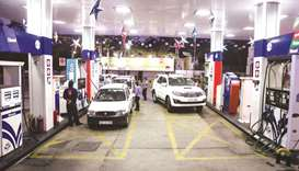 Customers refuel their vehicles at a Hindustan Petroleum Corp petrol station in New Delhi. There's b