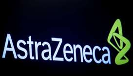 The company logo for pharmaceutical company AstraZeneca is displayed on a screen on the floor at the