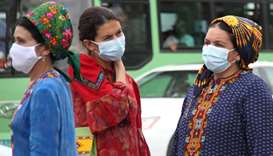 Women wearing protective face masks, used as a preventive measure against the spread of the coronavi