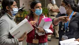 Lab workers from the Bangalore municipality Primary Health Centres (PHC) carry Rapid Antigen Covid-1