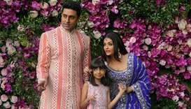 Actor Abhishek Bachchan, his wife actress Aishwarya Rai and their daughter Aaradhya pose during a ph