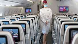 Qatar Airways introduced new disposable protective gowns for cabin crew that are fitted over their u