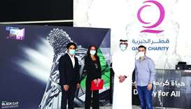 Qatar Charity and Black Cat Engineering & Construction officials