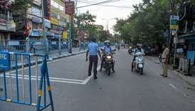 Police personnel stop motorists on a street after a new lockdown has been imposed until July 29 as a