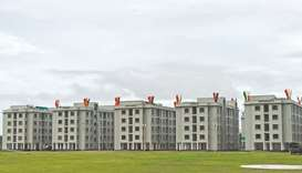 A general view of a complex with new apartment buildings for climate refugees, is pictured in Cox's