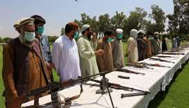 Members of the Taliban handover their weapons and join in the Afghan government's reconciliation and