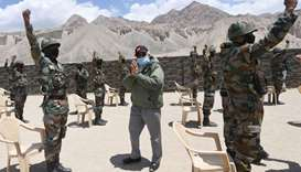 India's Prime Minister Narendra Modi gestures as he interacts with army soldiers during his visit to