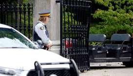 A police officer looks at the damaged gate at Rideau Hall, the property where Canadian Prime Ministe
