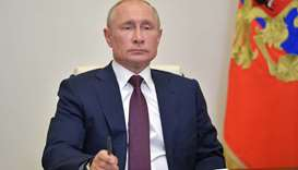 Russian President Vladimir Putin takes part in a a video conference call with members of the working