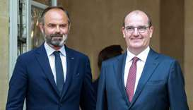 Former French Prime Minister Edouard Philippe (L) stands with newly-appointed Prime Minister Jean Ca
