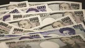 Japanese yen banknotes of various denominations are arranged for a photograph in Tokyo. Despite the