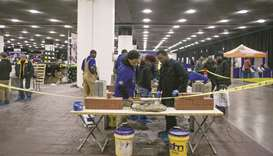 Officials demonstrate masonry techniques to job seekers during a construction career expo event in D