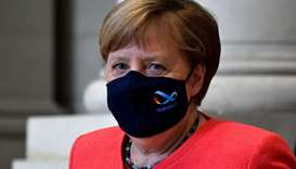 Merkel: had been quizzed earlier in the week on why she hadn't been seen more often with her mouth a