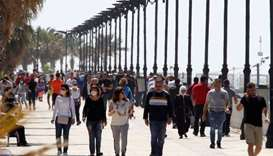 People walk along Beirut's seaside Corniche (file)