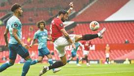 Manchester United's Bruno Fernandes (right) controls the ball during the Premier League match agains