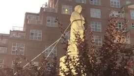 Protesters pull down the statue of Christopher Columbus in Baltimore, Maryland, US, in this still im