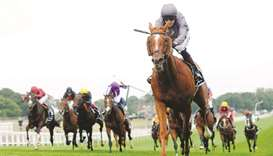 Jockey Emmet McNamara rides Serpentine to victory in the Derby Stakes at the Epsom Derby Festival, s
