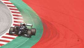 Mercedes' Finnish driver Valtteri Bottas steers his car during the qualifying round for the Austrian