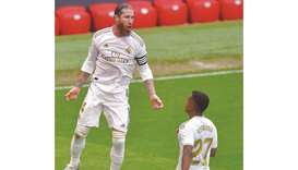 Real Madrid's Sergio Ramos (left) celebrates after scoring a goal during the La Liga match against A