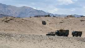 Indian Army personnel drive vehicles as they take part in a war exercise at Thikse in Leh district o